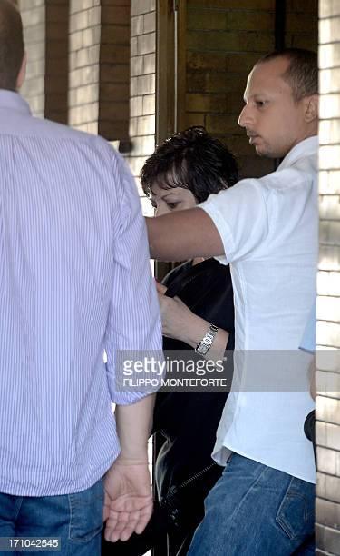 The sister of US actor James Gandolfini Johanna Antonacci leaves on June 21 2013 the morgue of Rome's Policlinico Umberto I hospital where the body...