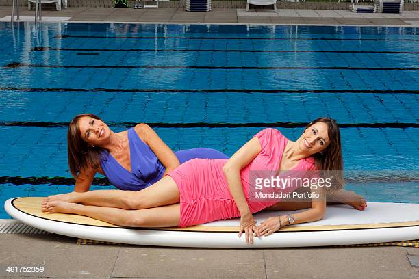 The sisters journalists and TV hosts Cristina Parodi and Benedetta Parodi in a photo shooting at the Sporting Club Marconi They're lying on a John...