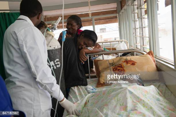 The sisters of breast cancer patient Jolly Komurembe react to news from the doctor that Jolly's heart is failing and death is imminent in the Solid...