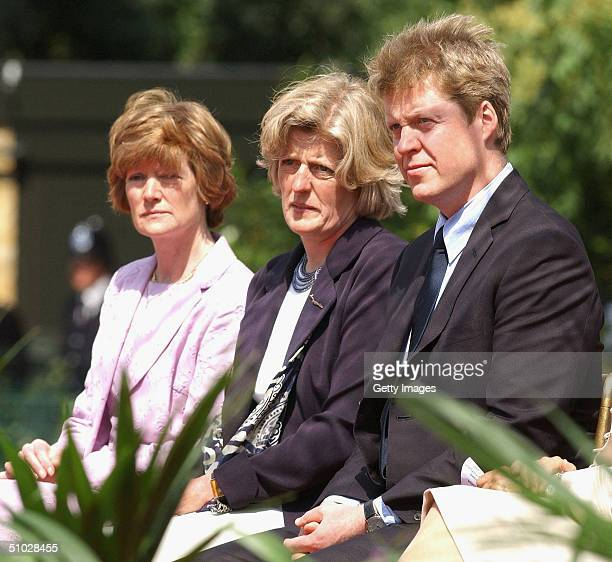 The sisters of the late Diana Princess of Wales Lady Sarah McCorquodale and Lady Jane Fellows applaud with their brother Earl Spencer at the opening...