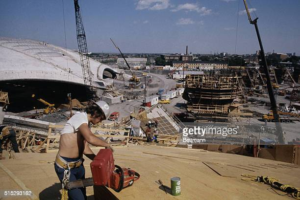 The site for the 1976 Olympics is still a clutter of cranes rods and boards as workmen press ahead to finish construction by opening day 7/17/1976...