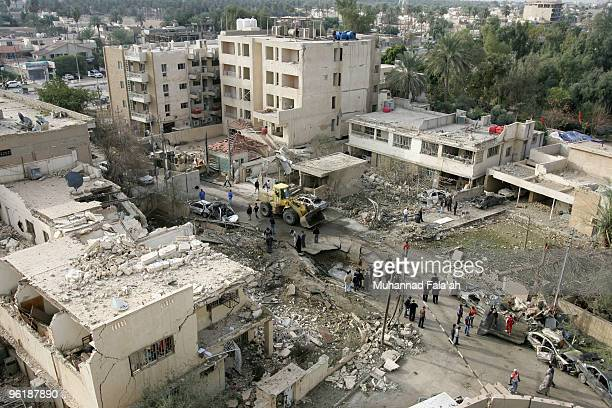 The site of a car bomb explosion is seen on January 26 2010 near the AlHamra hotel in Baghdad Iraq Three car bombs exploded on January 25 2010...
