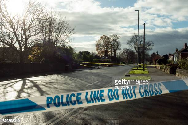 The site of a car crash in which five people including three children were killed after a stolen car crashed into a tree is cordoned off by police on...
