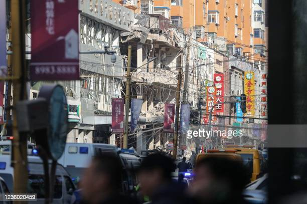 The site of a gas explosion accident at a restaurant is seen after the explosion ripped through a busy street killing at least three and injuring...