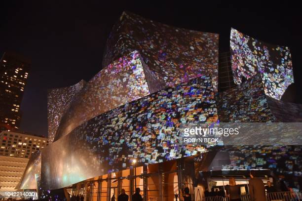 The sitespecific art installation called WDCH Dreams by media artist Refik Anadol is projected onto the undulating stainless steel facade of the...