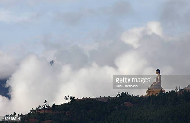 The Sitting Buddha is seen on the hill in Thimphu Bhutan on September 1 2013 The 169ft bronze statue which will be accommodating 125000 statues of...