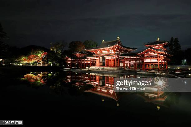 The sitting statue of the Amida Buddha in the Hoodo or Phoenix Hall of Byodoin temple glows on November 16 2018 in Uji Kyoto Japan A special...