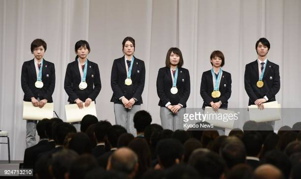 The six Japanese athletes who won gold medals at the Pyeongchang Olympics in South Korea stand on stage at the delegation disbandment ceremony in...