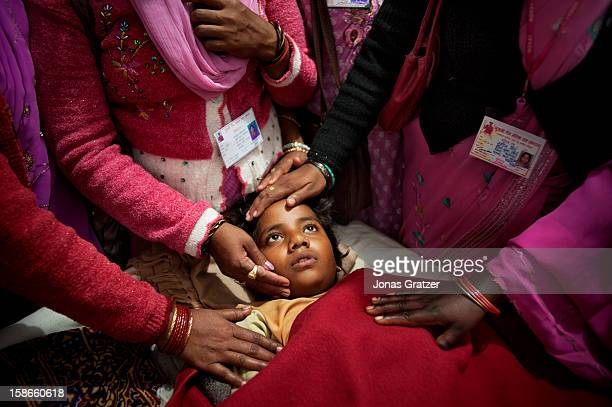 The six yearold girl is being comforted by members of Gulabi Gang She is admitted to the hospital after being raped by three men in the countryside...