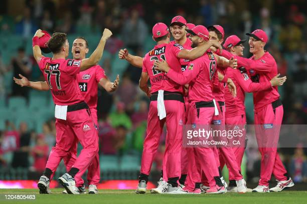 The Sixers celebrate victory after the Big Bash League Final match between the Sydney Sixers and the Melbourne Stars at the Sydney Cricket Ground on...