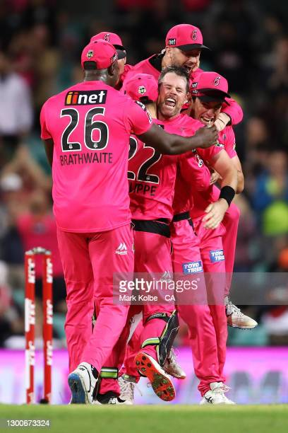 The Sixers celebrate victory in the Big Bash League Final match between the Sydney Sixers and the Perth Scorchers at the Sydney Cricket Ground on...