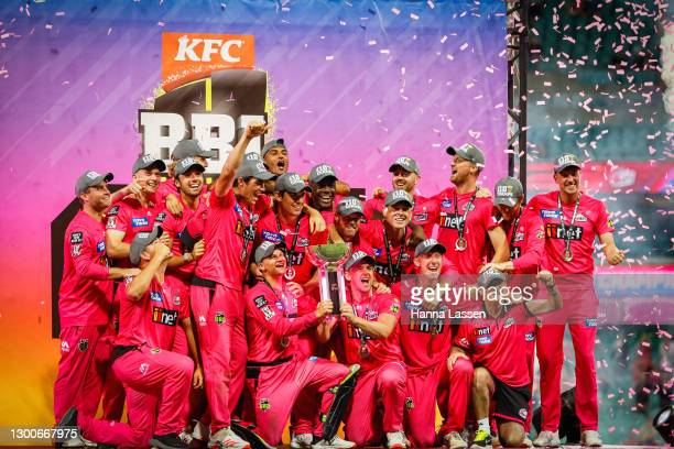 The Sixers celebrate with the trophy after winning the Big Bash League Final match between the Sydney Sixers and the Perth Scorchers at the Sydney...