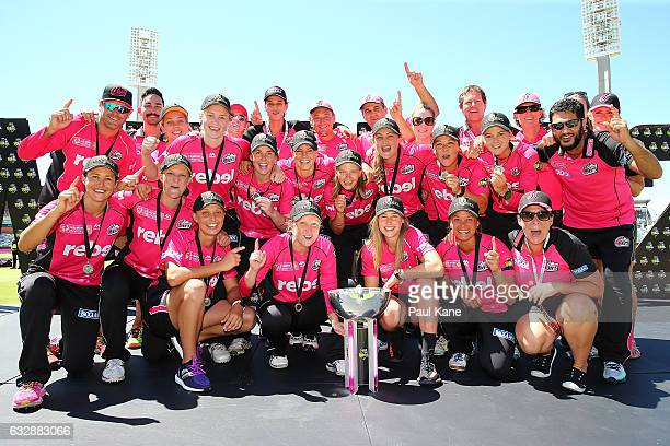 The Sixers celebrate with the trophy after winning the Women's Big Bash League match between the Perth Scorchers and the Sydney Sixers at WACA on...