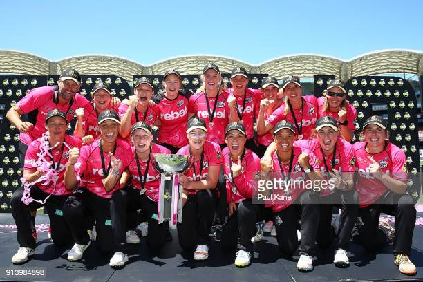 The Sixers pose with the troophy after winning the Women's Big Bash League final match between the Sydney Sixers and the Perth Scorchers at Adelaide...