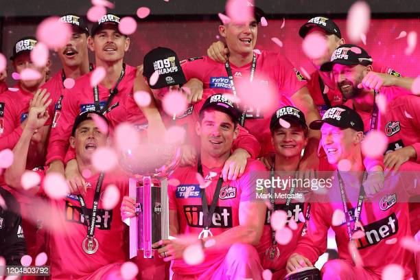 The Sixers pose with the trophy after winning the Big Bash League Final match between the Sydney Sixers and the Melbourne Stars at the Sydney Cricket...