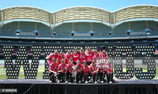 The Sixers pose with the trophy after winning the Women's Big Bash League final match between the Sydney Sixers and the Perth Scorchers at Adelaide...