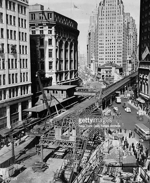 The Sixth Avenue El train is torn down.