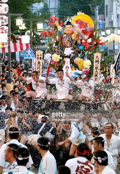 The sixth float 'EbisuNagare' rushes through Seido Street of Kushida Jinja Shrine during the Hakata Gion Yamakasa festival on July 15 2015 in Fukuoka...