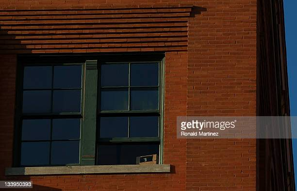 The sixth floor window of the former Texas School Book Depository now the Dallas County Administration Building on the 48th anniversary of JFK's...