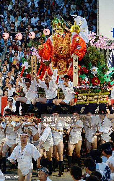 The sixth 'Yamakasa ' race through Seido Street of Kushidajinja Shrine during the Hakata Gion Yamakasa festival on July 15 2013 in Fukuoka Japan The...