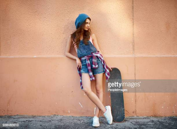 The skateboarder and her board