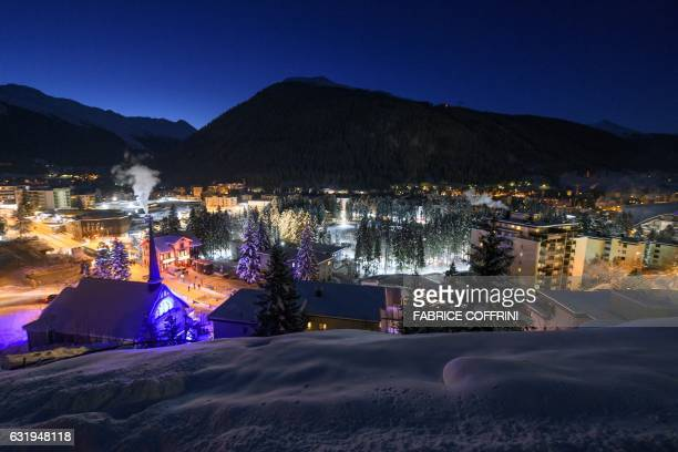 The ski resort of Davos is seen at sun rise on the the second day of the World Economic Forum on January 18 2017 With the world's elite holding its...