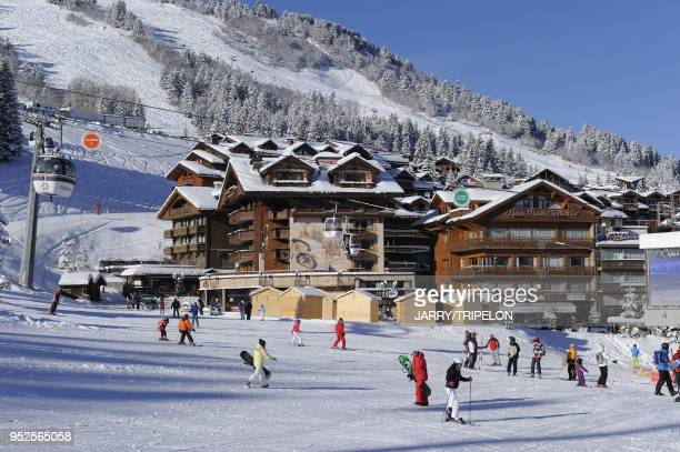 The ski slopes departure area with in background the hotel La Loze Courchevel 1850 ski resort Trois Vallees skiing area Tarentaise valley Savoie...