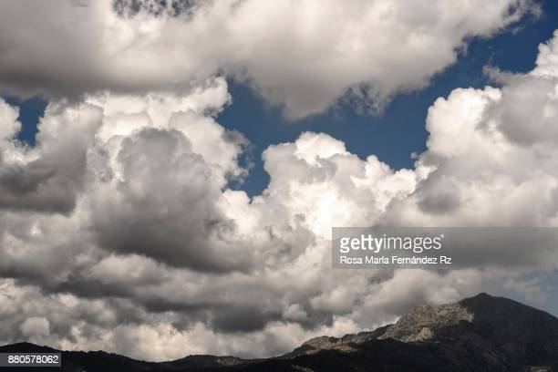 The skies above: Dramatic cloudy sky over mountain peak