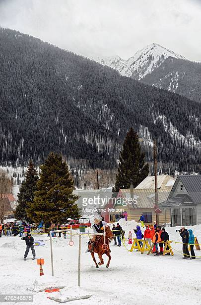 The skijoring course in Silverton requires the skier, while pulled behind a racing horse, to grab various rings on the course and make a few jumps....