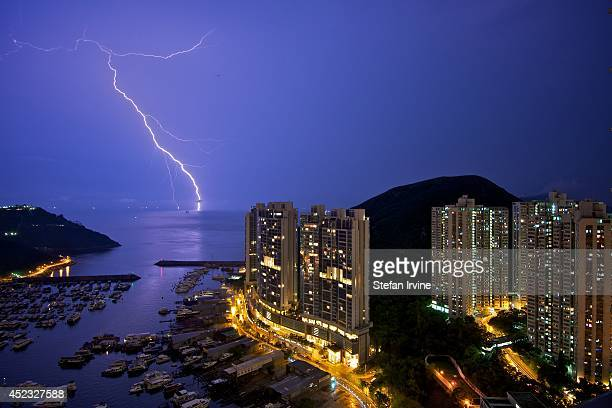 The sky around Aberdeen Marina is lit up by forked lightening as it strikes the South China Sea during a major thunderstorm in Hong Kong in the early...