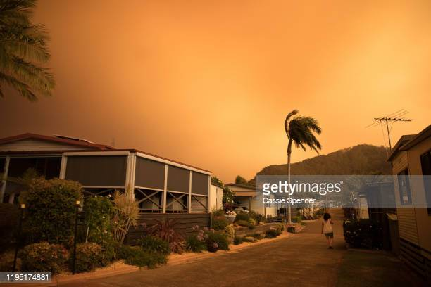 The sky is filled with smoke and ash on December 21 2019 in Shoalhaven Heads NSW Australia A catastrophic fire danger warning has been issued for the...