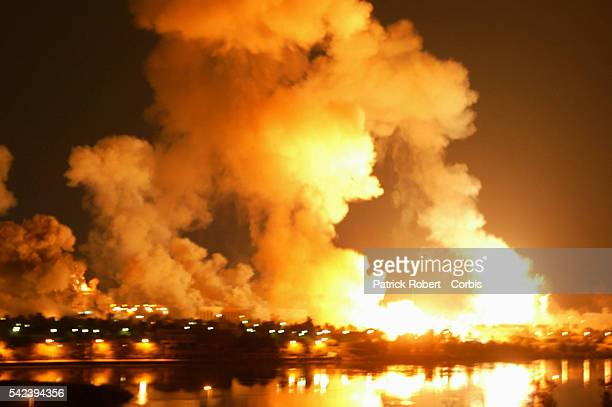 The sky is lit by explosions and Iraqi antiaircraft fire during the third night of the US shelling of Baghdad The Iraqi presidential palace complex...