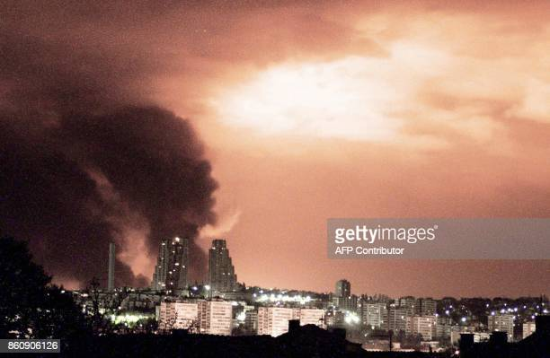 The sky over the Yugoslav capital Belgrade is illuminated red as smoke rises from a refinery at the industrial complex in the suburb of Pancevo after...