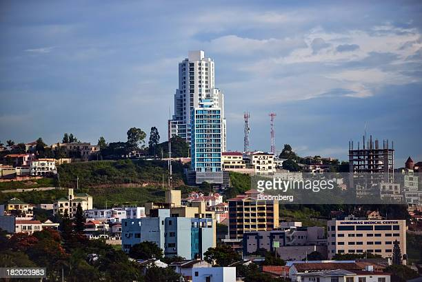 The Sky Residence Club, back center, the tallest building in the city, stands in Tegucigalpa, Honduras, on Tuesday, Sept. 3, 2013. Economic growth in...