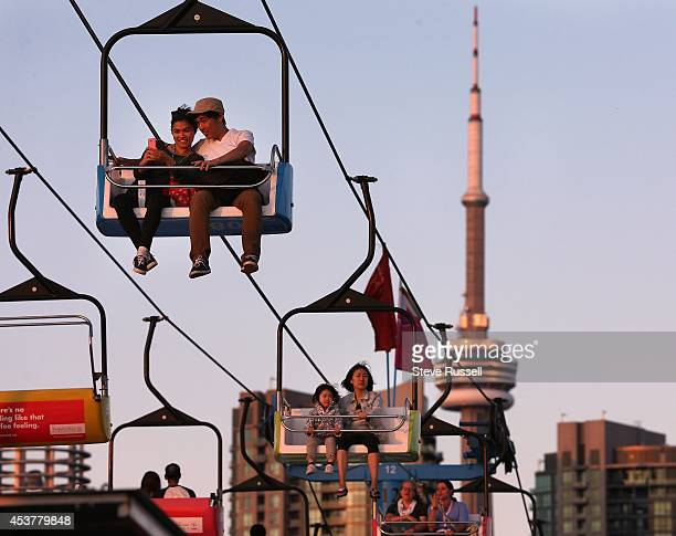 TORONTO ON AUGUST 15 The Sky Rider gives patrons a bird's eye view as the sun sets on the first night of the Canadian National Exhibition The Ex has...