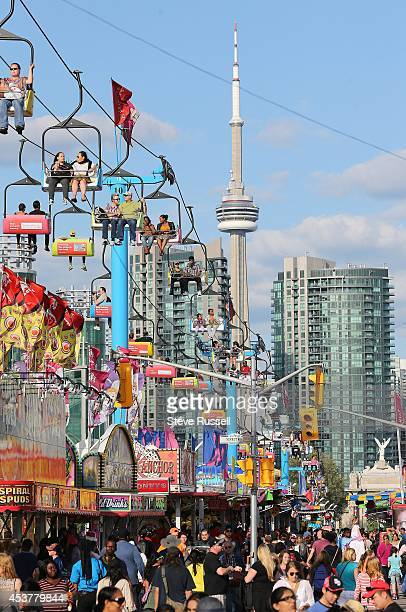 TORONTO ON AUGUST 15 The Sky Rider gives visitors a bird's eye view as the sun sets on the first night of the Canadian National Exhibition The Ex has...