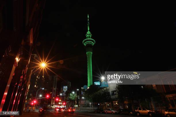 The Sky Tower illuminates green on March 17 2012 in Auckland New Zealand Sky Tower joins the Opera House in Sydney and Table Mountain in South Africa...