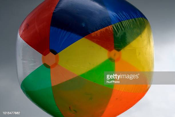 The sky turns dark behind a large beach ball as residents community members and locals enjoy a popup beach in North Philadelphia when thousands of...
