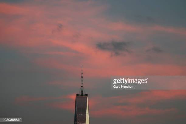 The sky turns pink behind One World Trade Center in New York City at sunset on October 3 2018 as seen from Hoboken New Jersey