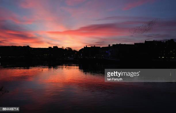 The sky turns red as the sun sets over Whitby Harbour on December 2 2017 in Whitby England The popular North Yorkshire seaside town enjoys a mild...