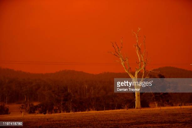 The sky turns red from the fires in Omeo on January 04 2020 in Double Bridges Australia Two people are dead and 28 remain missing following bushfires...