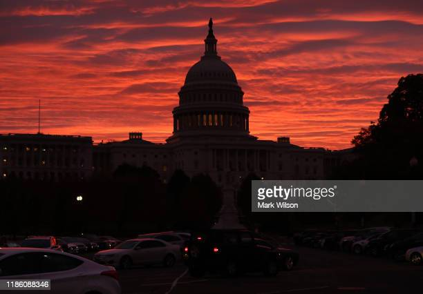 The sky turns to a fiery color as the sun begins to rise behind the U.S. Capitol building, on November 7, 2019 in Washington, DC. Chairman of the...