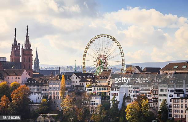 The skycape of The huge Ferris wheel and Basel Cathedral