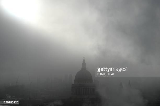 The skyline and dome of St Paul's Cathedral is seen through the fog in central London on December 7, 2020.