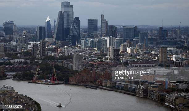 The skyline, including the office buildings of the City of London, is seen beyond the River Thames in London, England on September 02, 2020.