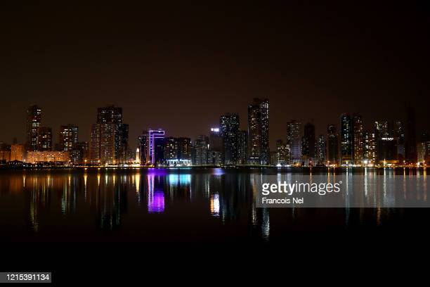 The skyline is lit up as workers during the night disinfectant the city to stop the spread of the coronavirus on March 28, 2020 in Sharjah, United...