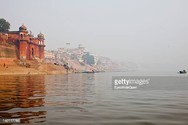The skyline of Benares with old palaces havelis and Ghats in the dawn at the Ganges river on February 1 2012 in the holy city of Varanasi Uttar...