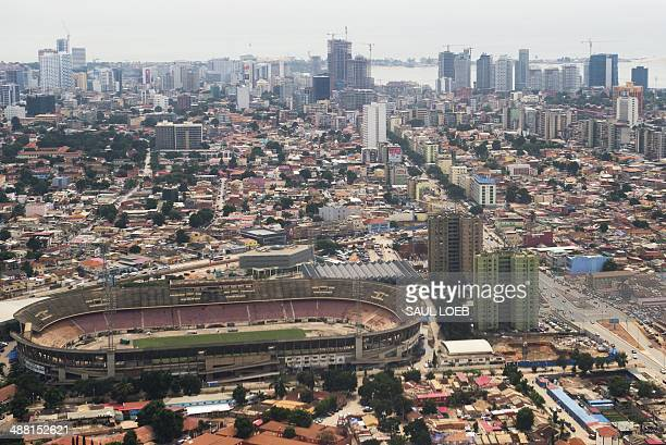 The skyline of central Luanda Angola with the 'Estadio da Cidadela' stadium in foreground is seen from an airplane May 4 2014 AFP PHOTO / POOL / Saul...