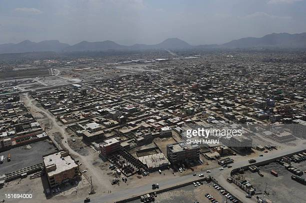 The skyline of Kabul is pictured during a helicopter flight from Kabul to Bagram Air Base for a prison handover ceremony on September 10 2012 The US...