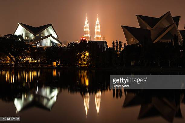 CONTENT] The skyline of Kuala Lumpur including the famous Petronas Towers reflecting in a lake north of the city in Titawangsa Kuala Lumpur is...
